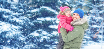 Happy family on winter walk. Dad and child baby girl. Happy family on a winter walk in nature. Dad and child baby girl Royalty Free Stock Photo