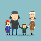 Happy family in winter wear are walking together Royalty Free Stock Image