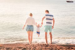 Free Happy Family With Baby On The Beach Stock Photography - 128366362