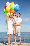 Happy Family With Colorful Balloons At Seaside Royalty Free Stock Images