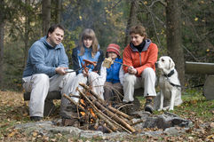 Happy Family With Dog Near Campfire Royalty Free Stock Images