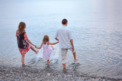 Free Happy Family With Girl On Beach Go In Water Royalty Free Stock Photo - 11808925