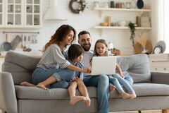 Free Happy Family With Kids Sit On Couch Using Laptop Stock Photography - 174243022