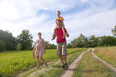 Happy Family With Pregnant Woman, Kid And Father