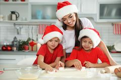 Free Happy Family With Santa Hats Cooking. Christmas Time Royalty Free Stock Photos - 160773988