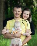 Happy family in wood Stock Photo