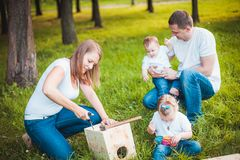 Happy family with Wooden birdhouse Stock Photo