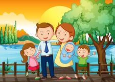 A happy family at the wooden bridge Royalty Free Stock Image