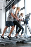Happy family workout on treadmill Stock Photography