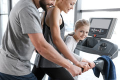 Happy family workout on treadmill Royalty Free Stock Photography