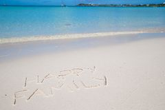 Happy family written on tropical beach white sand Royalty Free Stock Photography