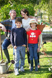Happy family in a yard Stock Photos