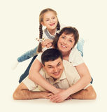 Happy family on yellow Stock Photos