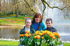 Happy family with yellow tulips. Royalty Free Stock Image