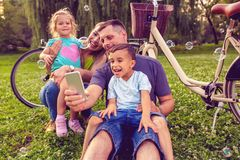 Happy family -young couple with their children have fun at beaut royalty free stock photos