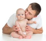 Happy Family Young Father And Child Baby Girl Kissing And Huggin