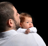 Happy family young father and new born infant child baby girl kissing stock images