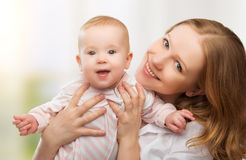 Happy family. young mother with baby Stock Images