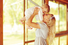 Happy family. Young mother and baby Royalty Free Stock Image