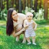 Happy family. Young mother and baby Royalty Free Stock Images