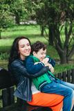 Happy family. Young mother and her five year old son spending time outdoor on a summer day. Happy family outdoor. Young mother and her five year old son spending royalty free stock images