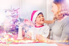 Happy family making Christmas decorations together stock photography