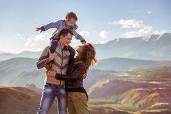 Happy family with son in mountains stock images