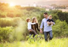 Happy family. Happy young family spending time together outside in green nature stock photos