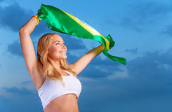 Happy fan of Brazilian football team Royalty Free Stock Image