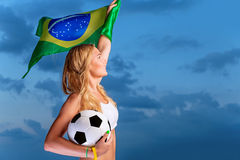 Happy fan of Brazilian football team Stock Photo