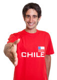 Happy fan from Chile reaching hand Stock Photo