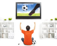 Happy fan watching soccer game and raised hands Royalty Free Stock Image