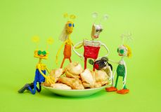 Happy fantastic family with cookies on a green background. Family consists of dad, mom, son, daughter and pet. Handmade art stock photos