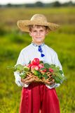 Happy farmer boy hold Organic Apples in Autumn Garden Stock Images