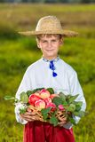 Happy farmer boy hold Organic Apples in Autumn Garden Stock Photo