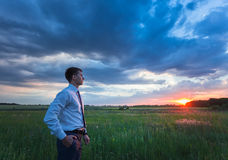 Happy farmer, businessman, standing in field with Royalty Free Stock Photos