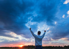 Happy farmer, businessman, standing in field with Stock Photo