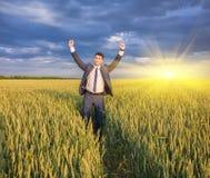 Happy farmer, businessman, standing in wheat field Stock Photo