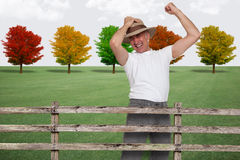 Happy farmer in the fall. Jumping Royalty Free Stock Photography