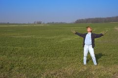 Happy Farmer in Farm Field Outside. Farmer in a farm field being happy for the sun and Mother Earth royalty free stock images