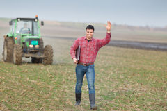 Happy farmer on field Stock Images