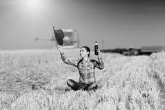 Happy farmer girl in the field Stock Photo