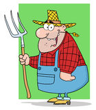 Happy farmer man carrying a rake Royalty Free Stock Images