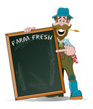 Happy Farmer pointing at his Big Sign Royalty Free Stock Photos