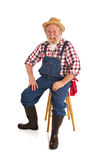 Happy farmer relaxes with corncob pipe Royalty Free Stock Photo