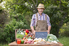 Happy farmer showing his produce Royalty Free Stock Photo
