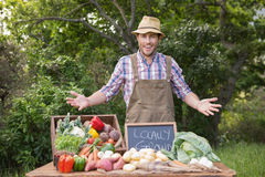 Happy farmer showing his produce Royalty Free Stock Photography