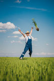 Happy farmer in the wheat against blue sky with white clouds Royalty Free Stock Images