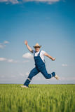 Happy farmer in the wheat Royalty Free Stock Photos
