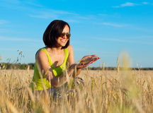 Happy farmer woman worker in wheat field Royalty Free Stock Images